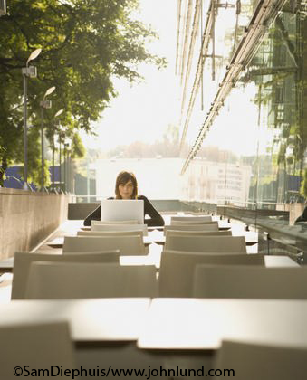 Woman using laptop at table outdoors